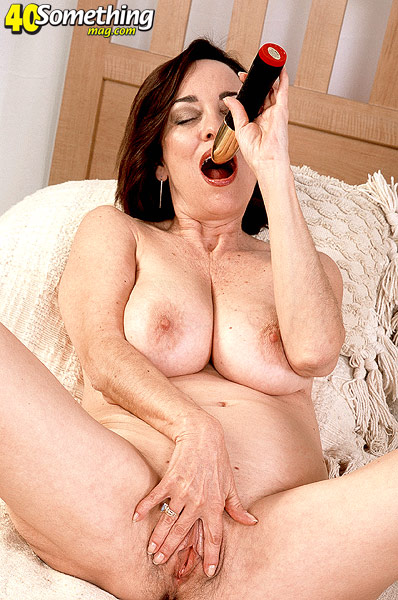 Milf pussy stuffed with huge dildo